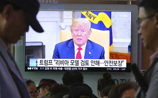 "A TV screen shows file footage of U.S. President Donald Trump during a news program at the Seoul Railway Station in Seoul, South Korea, Friday, May 18, 2018. North Korea strongly criticized South Korea over ongoing U.S.-South Korean military exercises on Thursday and said it will not return to talks with its rival until Seoul resolves its grievances. The signs read: "" Trump is not considering a so-called Libya model. """