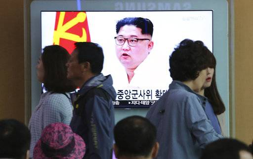 People pass by a TV screen showing file footage of North Korean leader Kim Jong Un during a news program at the Seoul Railway Station in Seoul, South Korea, Friday, May 18, 2018. South Korea said Friday it believes North Korea remains committed to improving relations despite strongly criticizing Seoul over ongoing U.S.-South Korean military drills and insisting it will not return to inter-Korean talks unless its grievances are resolved.