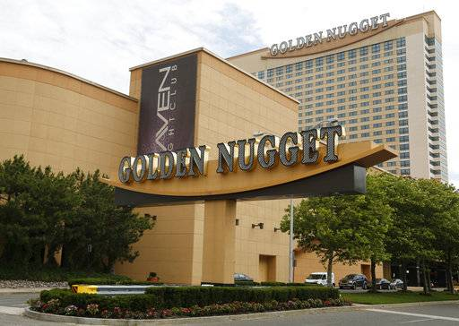 FILE - In this June 19, 2017, file photo, the Golden Nugget Hotel and Casino stands in Atlantic City, N.J. The Supreme Court ruling earlier this week allows states to offer sports betting. Churchill Downs Inc. wasted little time taking a step on this new frontier. The company announced an agreement Wednesday, May 16, with Golden Nugget Atlantic City to enter online gambling and sports betting in New Jersey.
