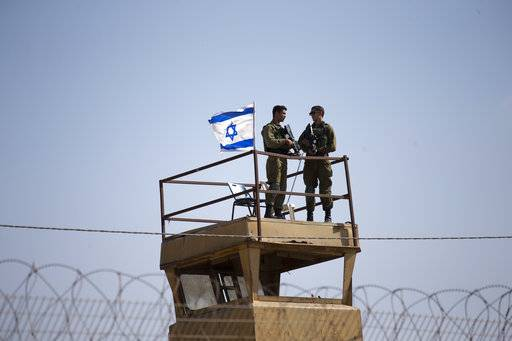 FILE - In this Tuesday, May 15, 2018 file photo, Israeli soldiers guard on top of a watch tower in a community along the Israel- Gaza Strip Border. The modern Middle East has been plagued by ruinous wars: country versus country, civil wars with internecine and sectarian bloodletting, and numerous eruptions centered in the Israeli-Palestinian conflict. But never in the last 70 years have they seemed as interconnected as now with Iran and Saudi Arabia vying for regional control, while Israel also seeks to maintain a military supremacy of its own.