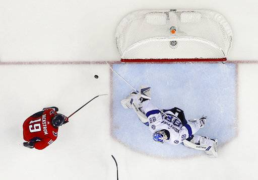 Tampa Bay Lightning goaltender Andrei Vasilevskiy (88) stops a shot by Washington Capitals center Nicklas Backstrom (19), from Sweden, during the third period of Game 4 of the NHL Eastern Conference finals hockey playoff series, Thursday, May 17, 2018, in Washington.