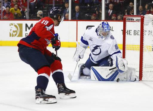 Tampa Bay Lightning goaltender Andrei Vasilevskiy (88) stops a shot by Washington Capitals center Nicklas Backstrom (19) during the second period of Game 4 of the NHL hockey Eastern Conference finals Thursday, May 17, 2018, in Washington.