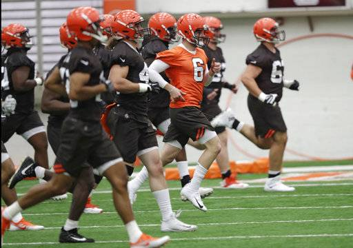 "FILE - In this May 4, 2018, file photo, Cleveland Browns quarterback Baker Mayfield (6) runs a drill during rookie minicamp at the NFL football team's training camp facility in Berea, Ohio. A person familiar with the decision says the Browns will appear on HBO's ""Hard Knocks"" this season. Coming off a historic 0-16 season, the Browns were chosen after declining the opportunity several times, said the person who spoke Thursday, May 17, to The Associated Press on condition of anonymity."