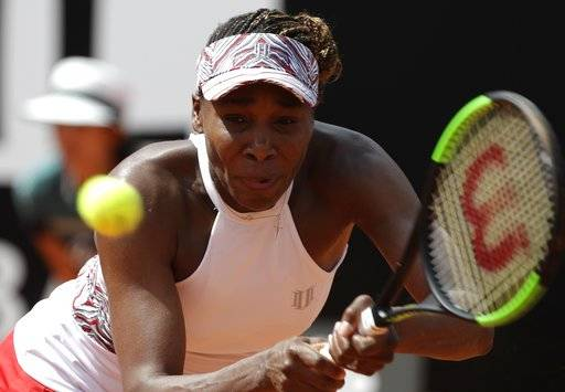Venus Williams returns the ball to Estonia's Anett Kontaveit, at the Italian Open tennis tournament in Rome, Thursday, May 17, 2018
