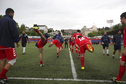 In this Friday, May 11, 2018 photo, players of the soccer national team of the self-proclaimed Republic of Artsakh attend a training session, in Stepanakert, the capital of the disputed territory of Nagorno-Karabakh. The ethnic Armenian team has the shirts and the shoes, and even practices five days each week on an artificial field a short distance from the center of Stepanakert. The reason for the lack of opponents has nothing to do with sports and everything to do with politics. UEFA and FIFA have a general policy of not allowing teams into competition if they don't represent an internationally recognized country or territory.