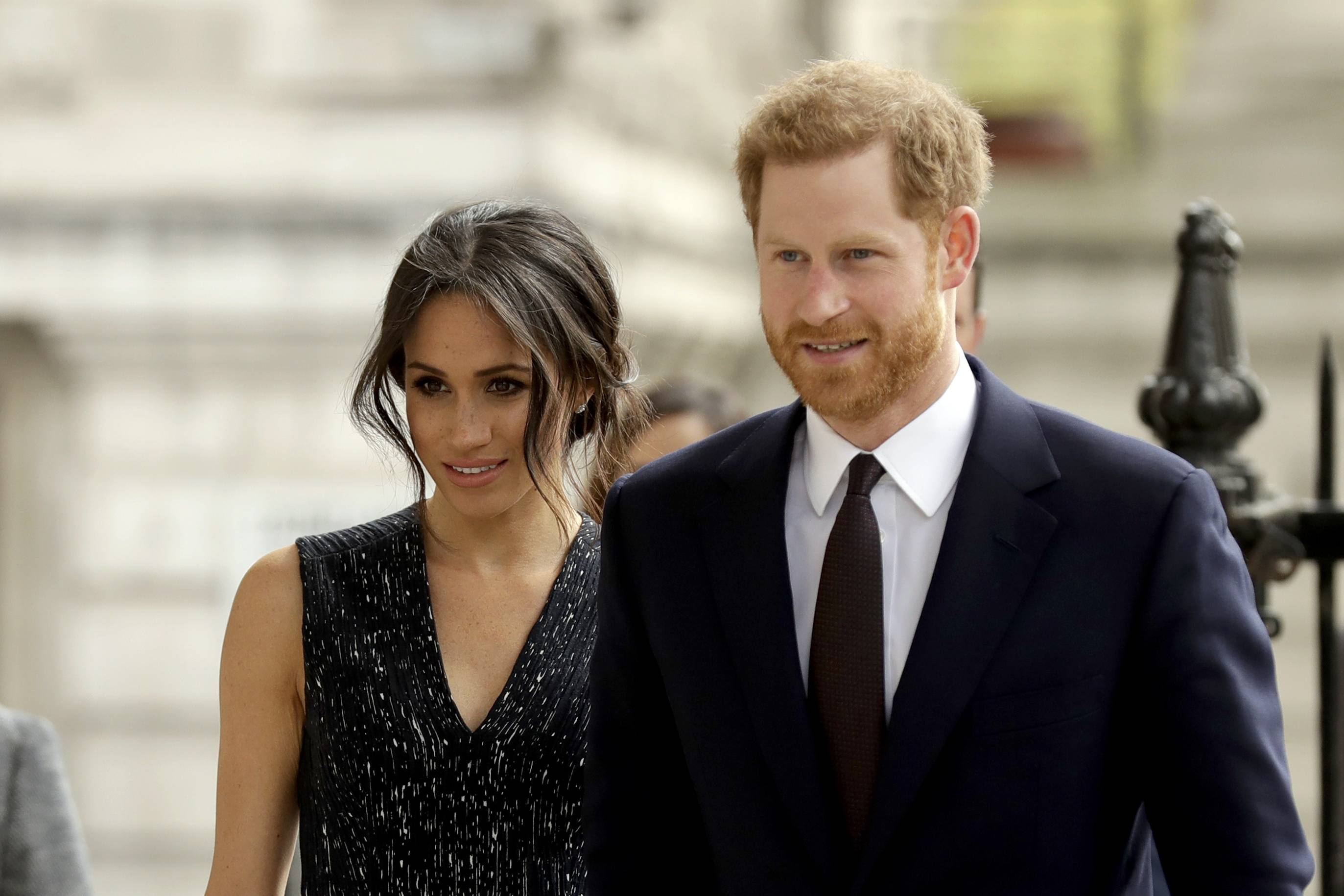 Britain's Prince Harry and his fiancee Meghan Markle. With just one day to go before the royal event of the year, palace officials have said that Prince Charles, the heir to the British throne, will now walk Markle down the aisle.