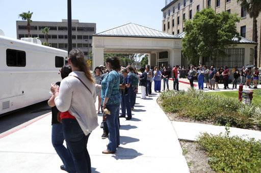 People wait to give blood after news of the shooting at Santa Fe High School at Jennie Sealy Hospital at the University of Texas Medical Branch in Galveston, Texas on Friday, May 18, 2018. MD Anderson Cancer Center brought a van from their Blood Donor Center in Houston. (Kelsey Walling/The Galveston County Daily News via AP)