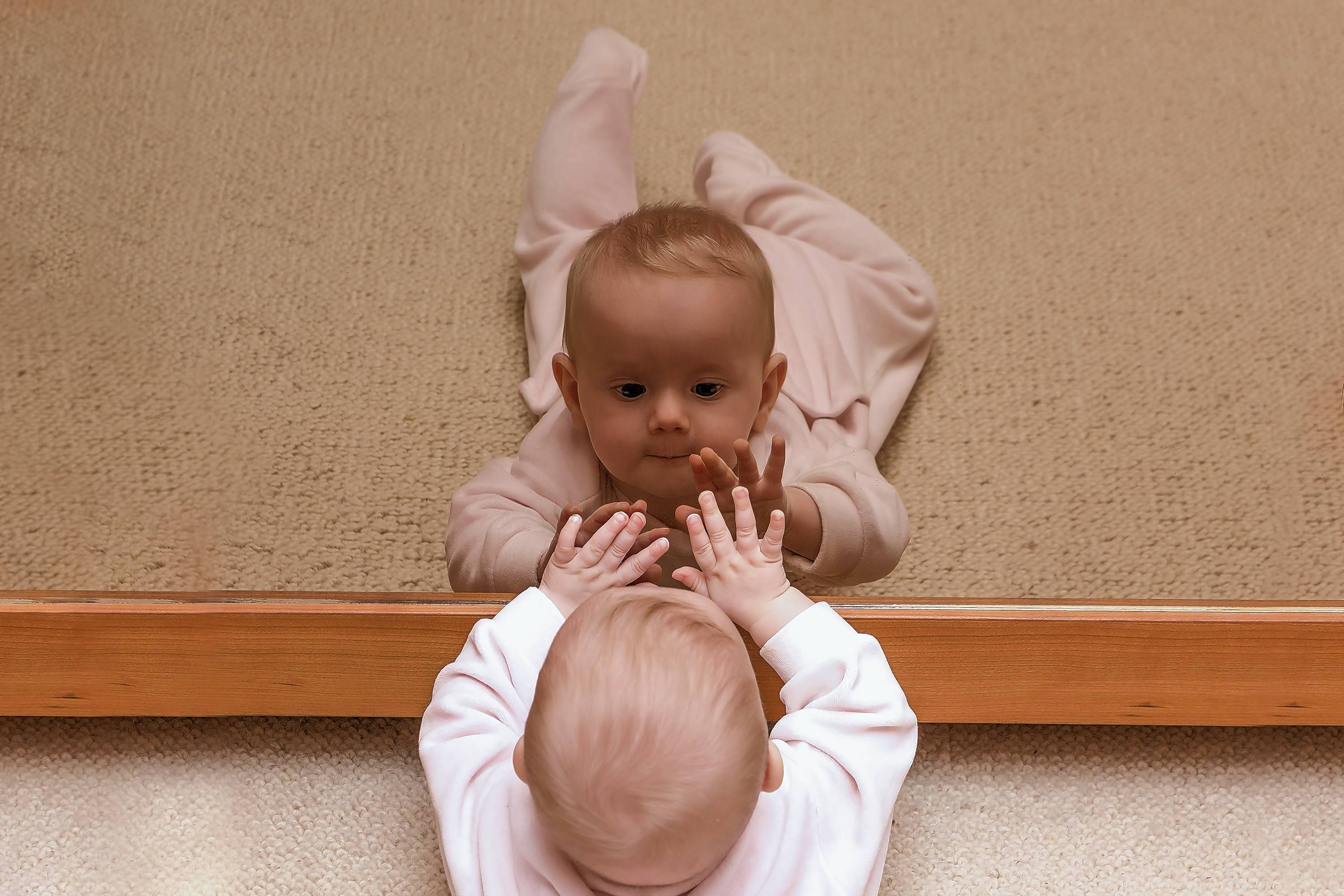 Between 6 to 9 months old, a baby begins to enjoy looking at herself in the mirror.
