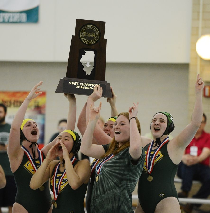 The Stevenson girls water polo team celebrates its state championship following Saturday's victory over Fenwick in Lincolnshire.