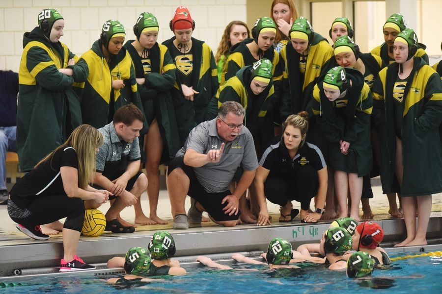 Stevenson coach Jeff Wimer talks to his team during the girls water polo state championship game against Fenwick.