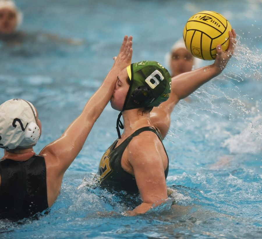 Stevenson's Claire Haas scores a goal despite contact to the face by Fenwick's Molly McGuire during the girls state water polo championship game Saturday.