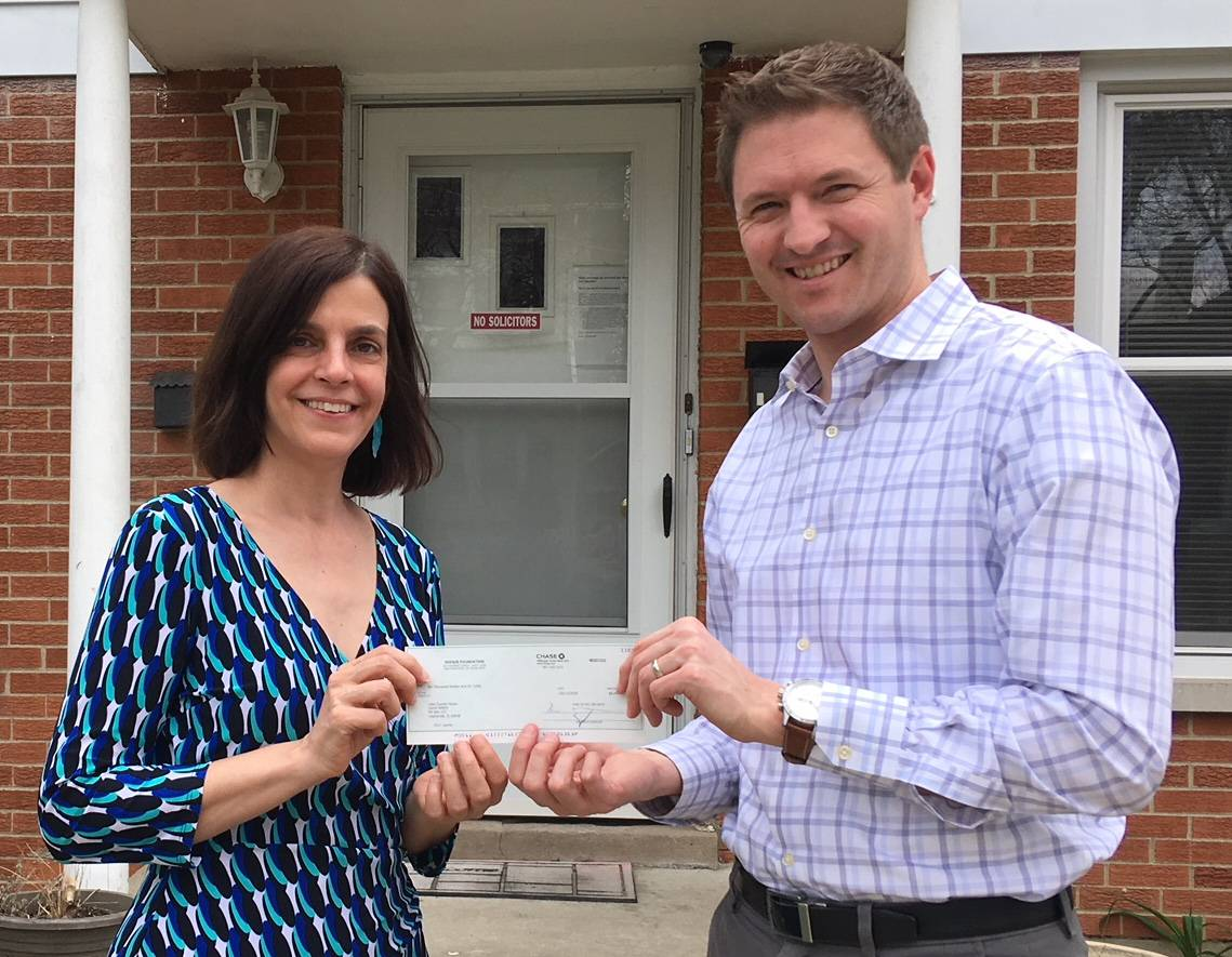 Ryan Delp of Bradish Associates (right) recently presented a donation of $6,000 on behalf of Socius Insurance Services to Lake County Haven Executive Director Laura Sabino. The money will help the organization open a new shelter.Photo courtesy of Bradish Associates