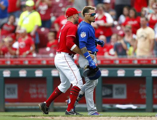 Cincinnati Reds' Joey Votto, left, restrains Chicago Cubs' Javier Baez, right, after Baez exchanged words with Reds relief pitcher Amir Garrett following a strike out in the seventh inning in the first baseball game of a doubleheader, Saturday, May 19, 2018, in Cincinnati.
