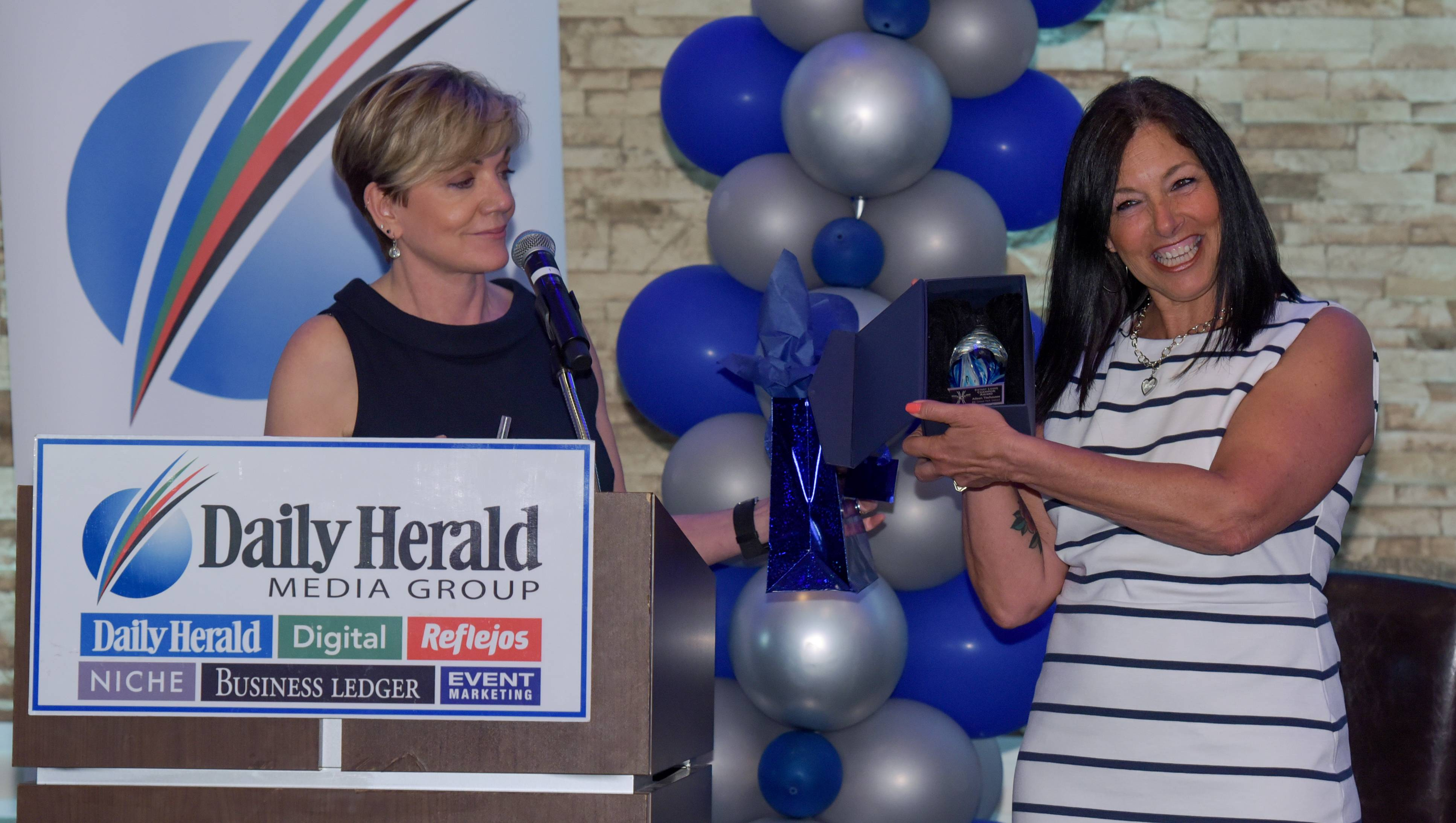 The Daily Herald Media Group's Eileen Brown presents the team captain award to Aileen Tischauser of Elk Grove Strong.