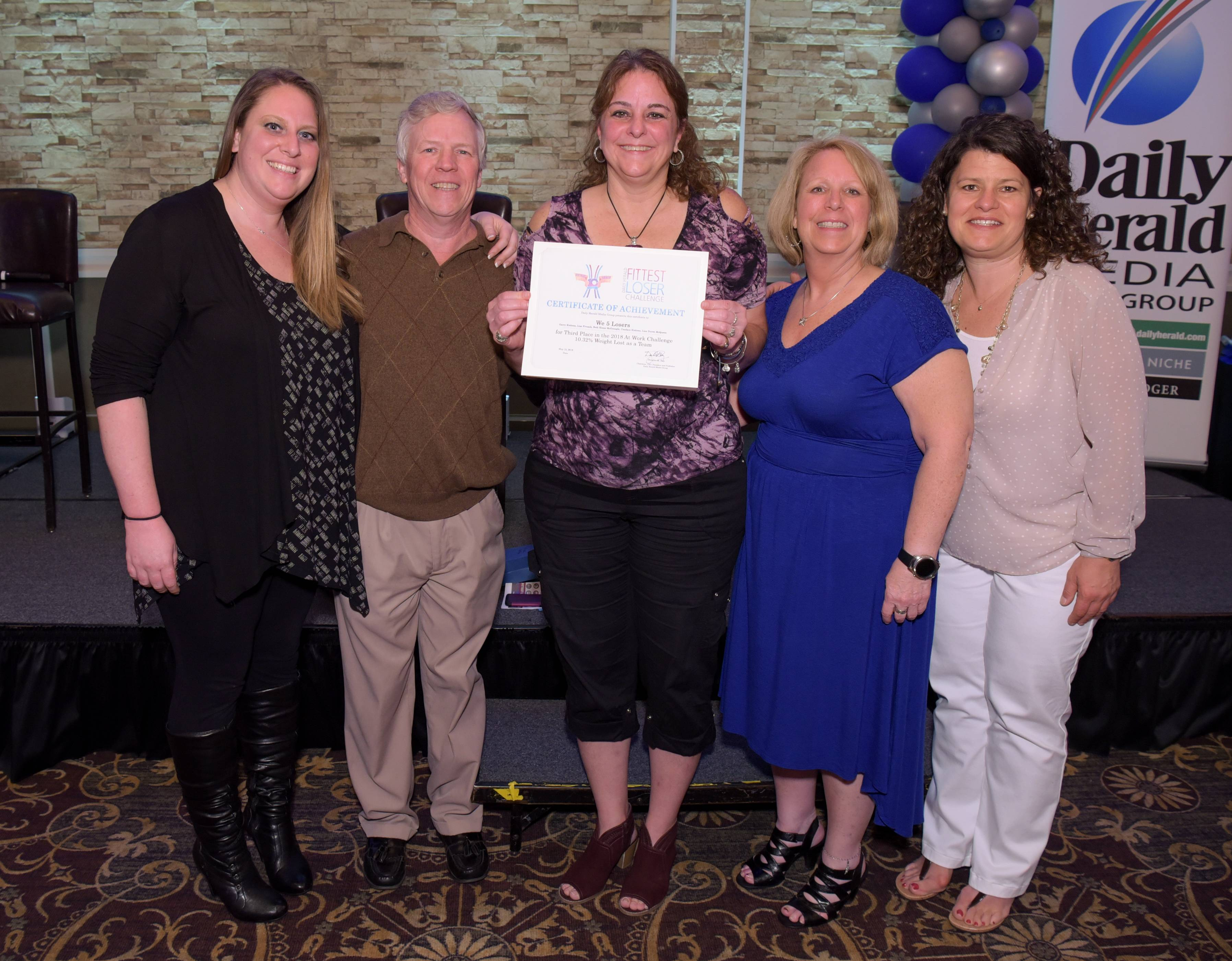 2018 Daily Herald Fittest Loser Challenge At Work 3rd place team We 5 Losers of Kieth Wallace during the awards ceremony at Chandler's Banquets is Schaumburg on Tuesday, May 15, 2018.