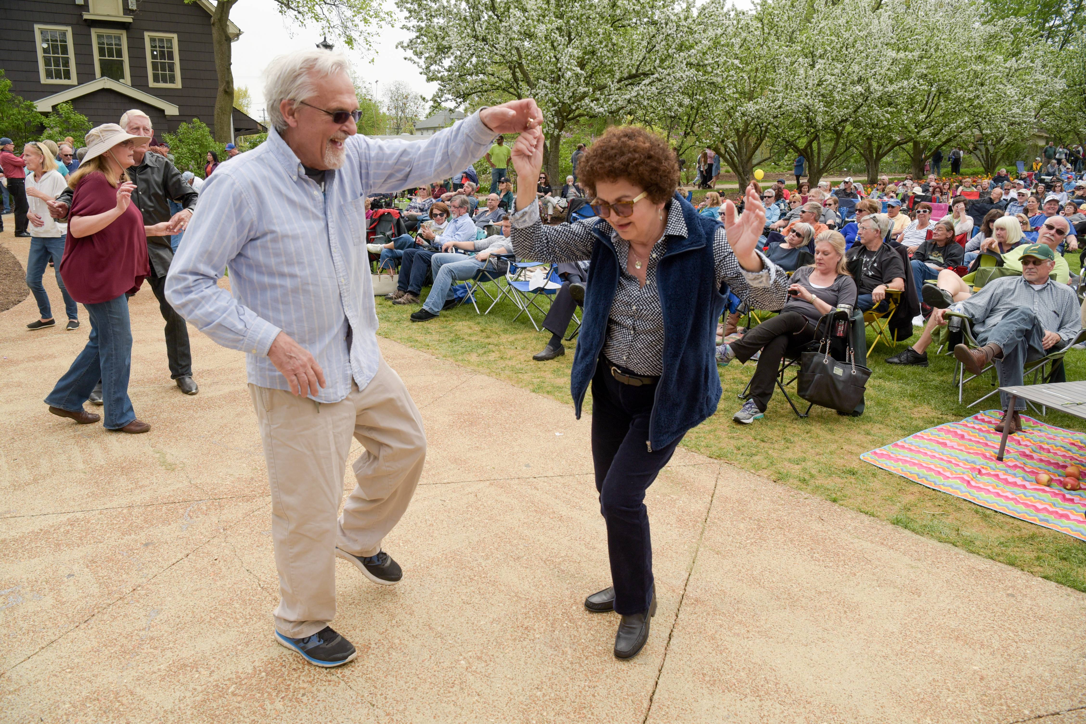 Don and Cynthia Obuch, of Downers Grove dance to the music of Brass from the Past during a Mother's Day concert at Lilacia Park in Lombard on Sunday, May 13, 2018.