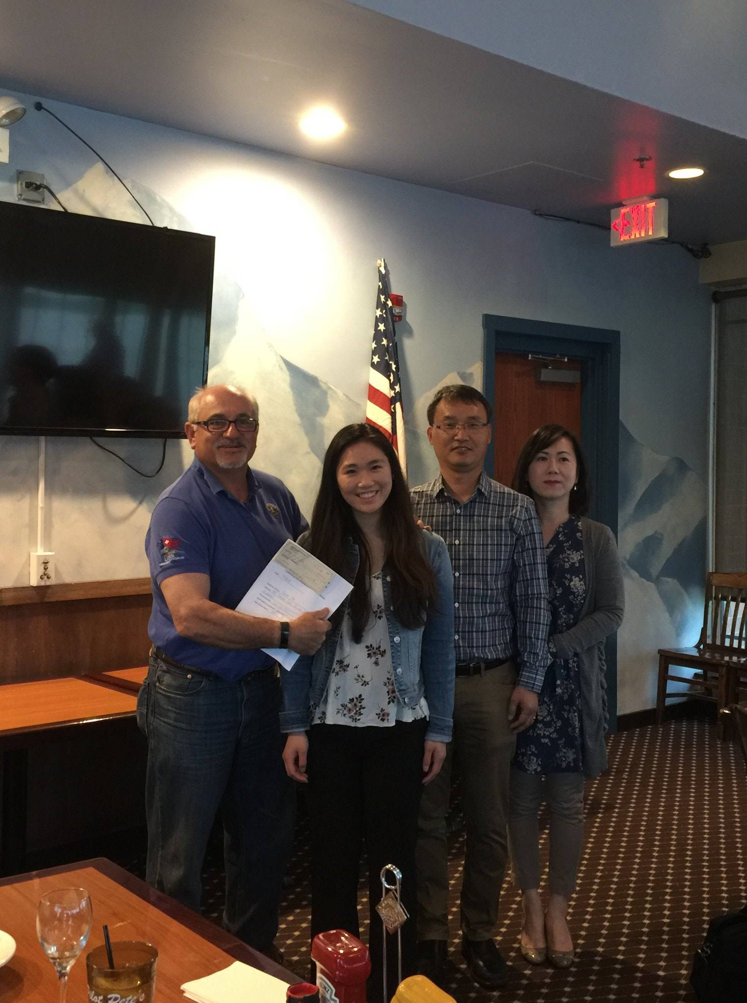 Club President Chris Marks presented the Schaumburg-Hoffman Lions Club 2018 scholarship to Joanne Cho and her parents on May 3, 2018 at Pilot Pete's Restaurant in Schaumburg.Michael Marks