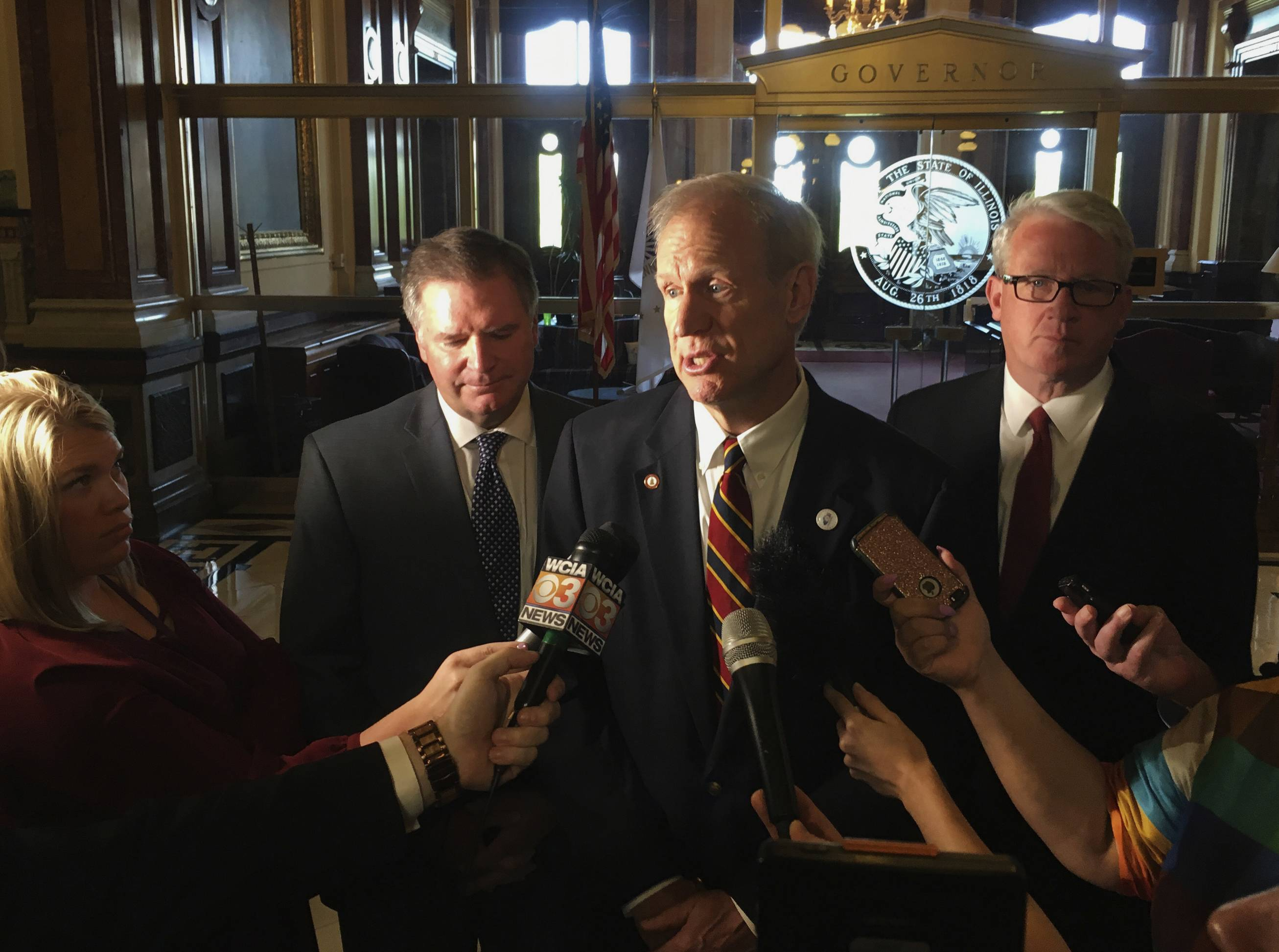 Gov. Bruce Rauner, center, wants to reinstate the death penalty in the state. He added the provision Monday into gun legislation favored by Democrats. The bill now goes back to the Democratic-controlled Legislature for approval.