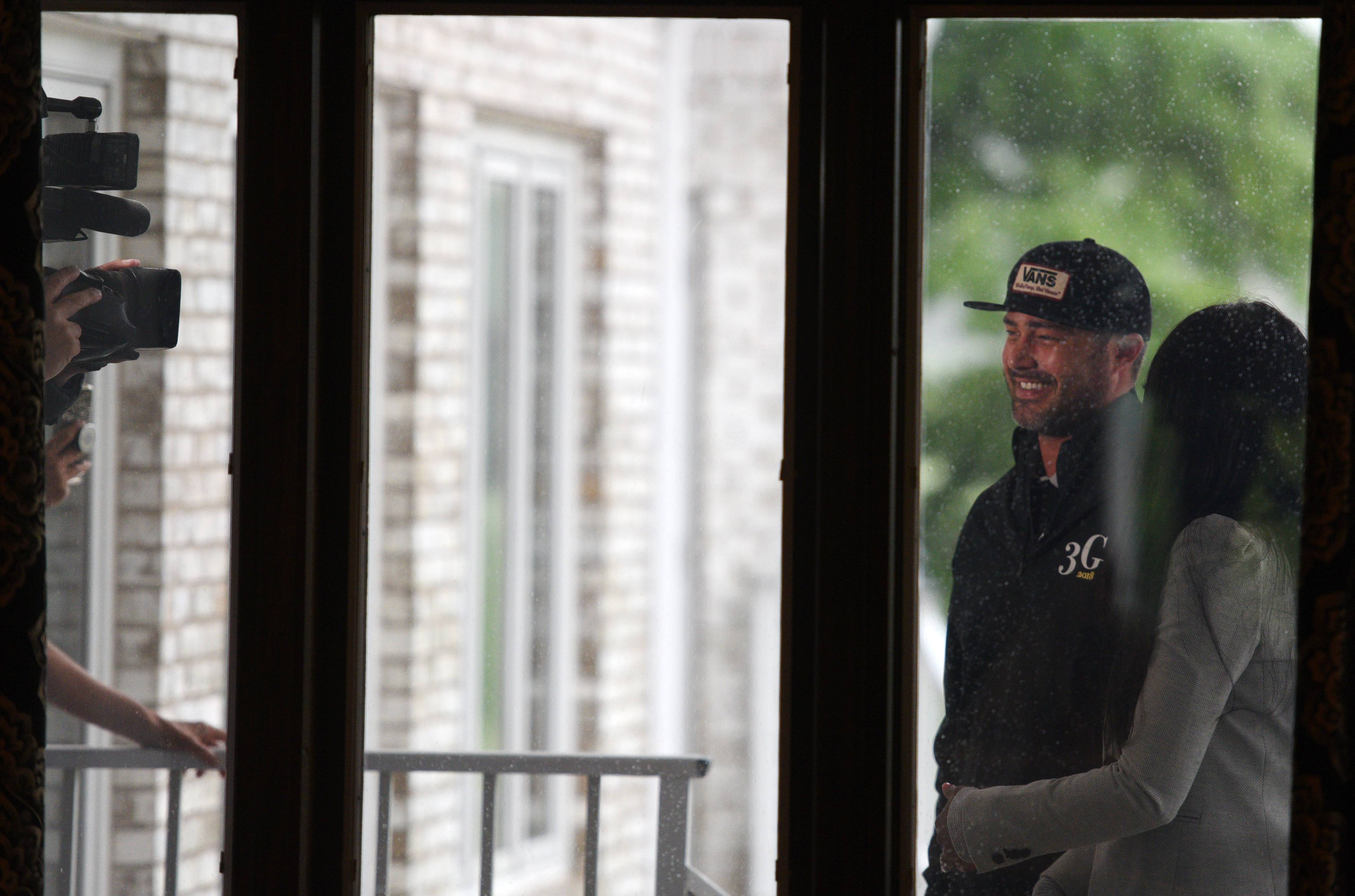 "Actor Taylor Kinney does an interview outside Monday as the rain washes out the 2nd Annual Golf. Give. Gala. outing at the St. Charles Country Club. Kinney stars as Lt. Kelly Severide on ""Chicago Fire,"" ""Chicago P.D."" and ""Chicago Med."""