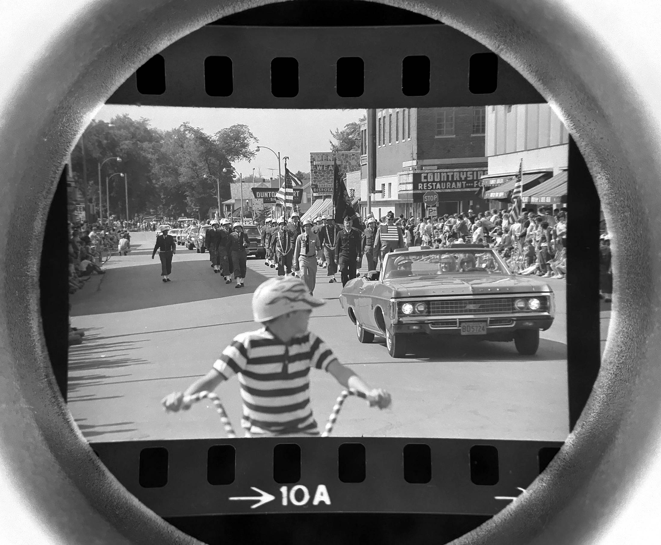 The Daily Herald Archives, Assignment #13,540, photo by Larry Cameron: A Memorial Day parade moves through downtown Arlington Heights in May 1969