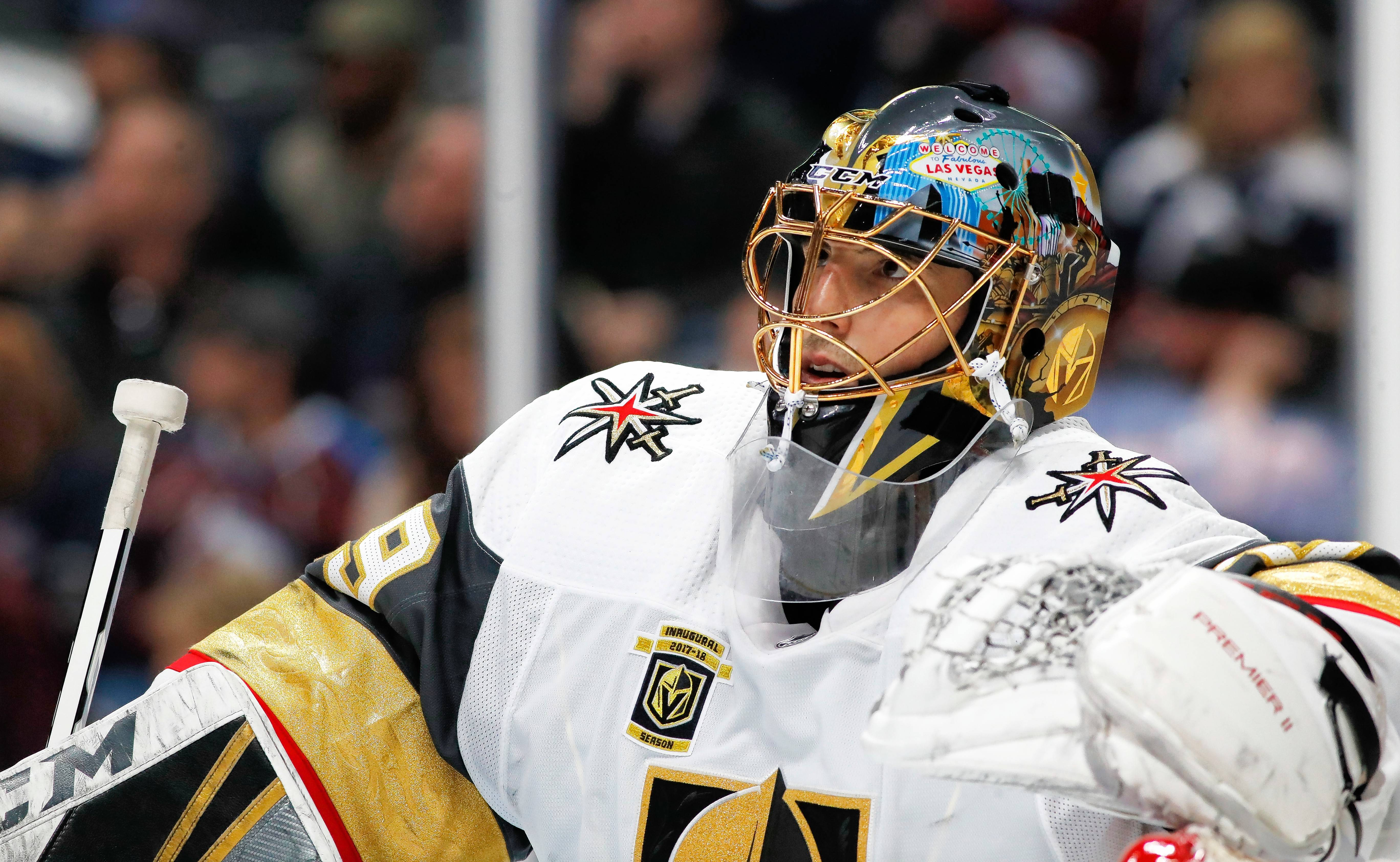 Vegas Golden Knights goaltender Marc-Andre Fleury leans on the top of the net during a time out against the Colorado Avalanche in the third period of an NHL hockey game Saturday, March 24, 2018, in Denver. Colorado won 2-1 in a shootout. (AP Photo/David Zalubowski)