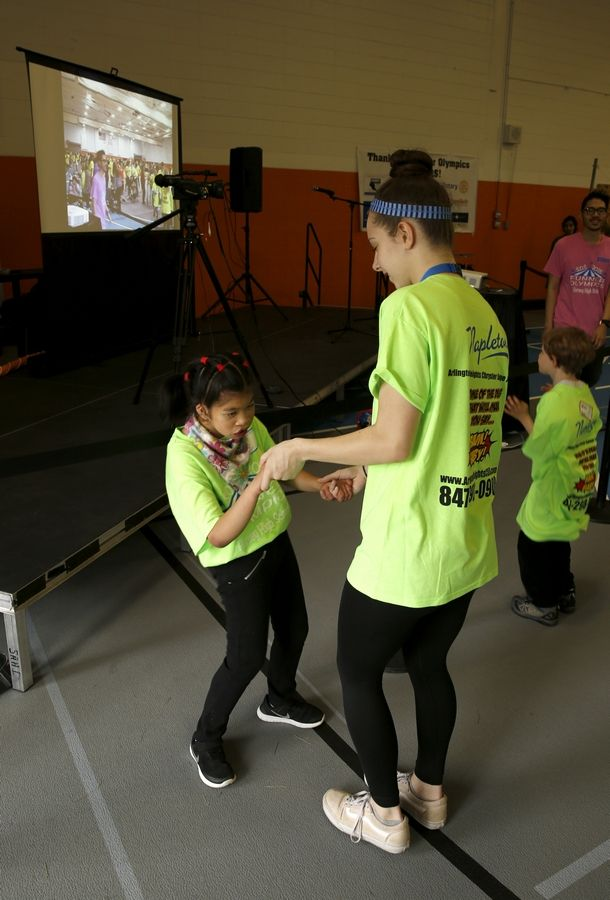 Shan of London School dances with Jessie Carlquist, right, on Tuesday as part of the Funner Olympics at John Hersey High School.