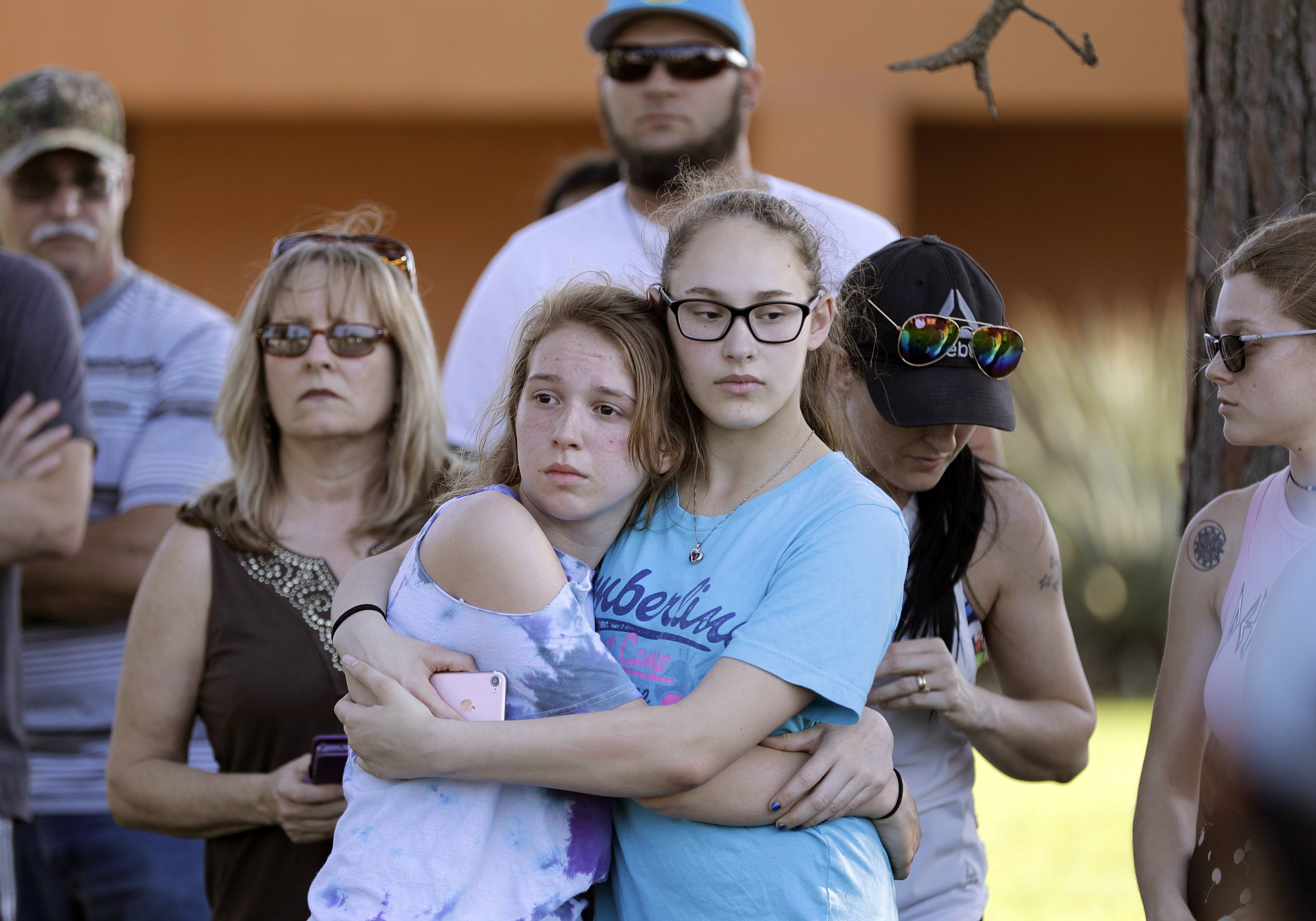 Mourners wait for the start of a prayer vigil following a deadly shooting at Santa Fe High School in Santa Fe, Texas. If you want to know where mass school shootings are most likely to occur, look no farther than small-town and suburban America.