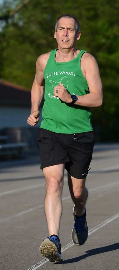 Jimmy Kowalski of the Busse Woods Running Club's Couch to 5K program works out at Ost Field in Palatine.