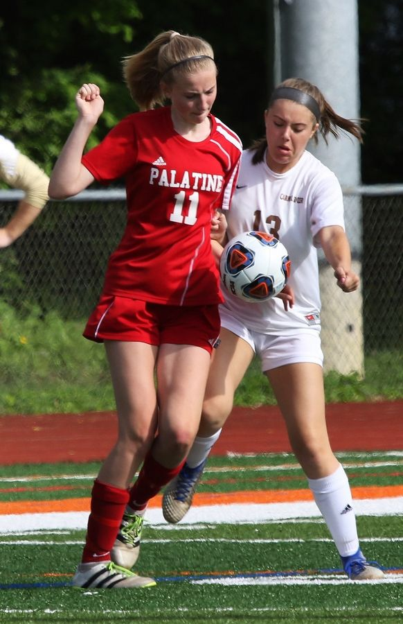 Palatine midfielder Olivia Radtke battles Carmel defender Madelyn Splitt for a possession in Class 3A sectional semifinal play Tuesday in Libertyville.