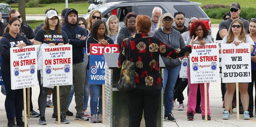 The Rev. C.J. Hawking speaks Tuesday to striking Kane County probation officers and youth counselors at the Kane County Judicial Center. Hawking is executive director of Arise Chicago, an interfaith group that advocates for workers.