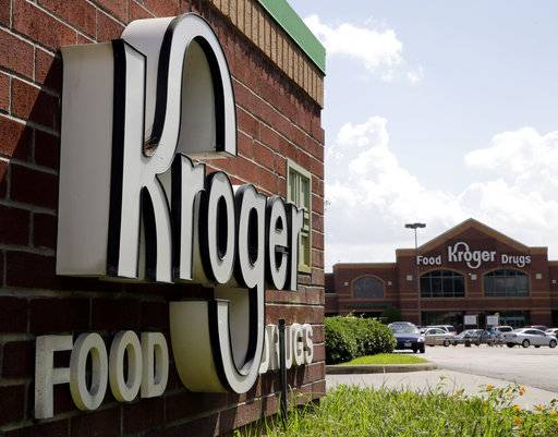 FILE - This June 17, 2014, file photo, shows a Kroger store in Houston. Kroger, looking to take a bigger bite of the online grocery market, is buying meal-kit seller Home Chef. Home Chef, like other meal-kit companies, sends a box of raw ingredients and recipes to its subscriber's doorsteps. Kroger will pay $200 million for Chicago-based Home Chef, and may pay an additional $500 million over five years if sales reach certain milestones. Kroger plans to put Home Chef kits in its supermarkets.