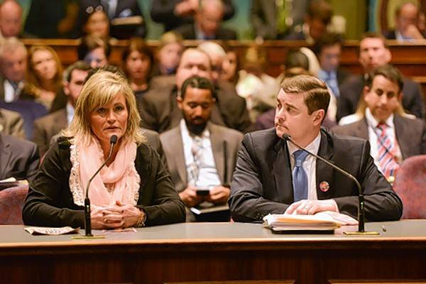 Shelly LeGere, left, appeared with state Sen. Chris Nybo at an Illinois Senate committee meeting in April 2016 to testify for the Annie LeGere Law. Nybo now is sponsoring an amendment to the law that will encourage medical professionals to participate in the initiative to equip police officers with EpiPens.