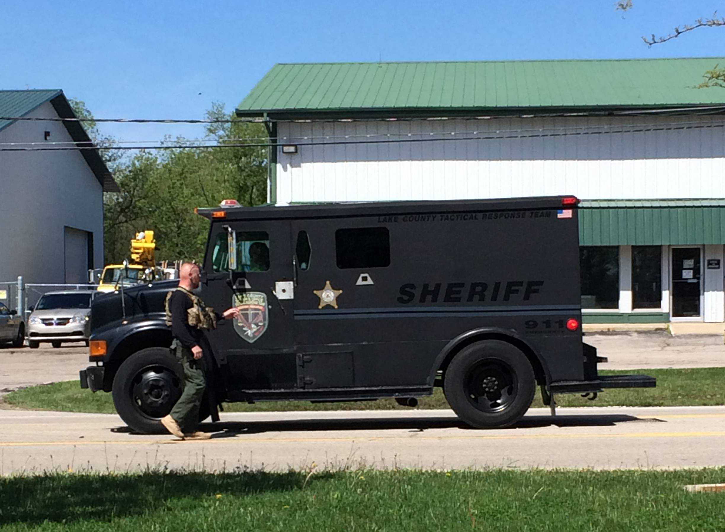 Lake County tactical response team vehicles outside a single-family house in Antioch Township that police surrounded in search of a man and woman who were involved in a confrontation with police early Wednesday, authorities said.