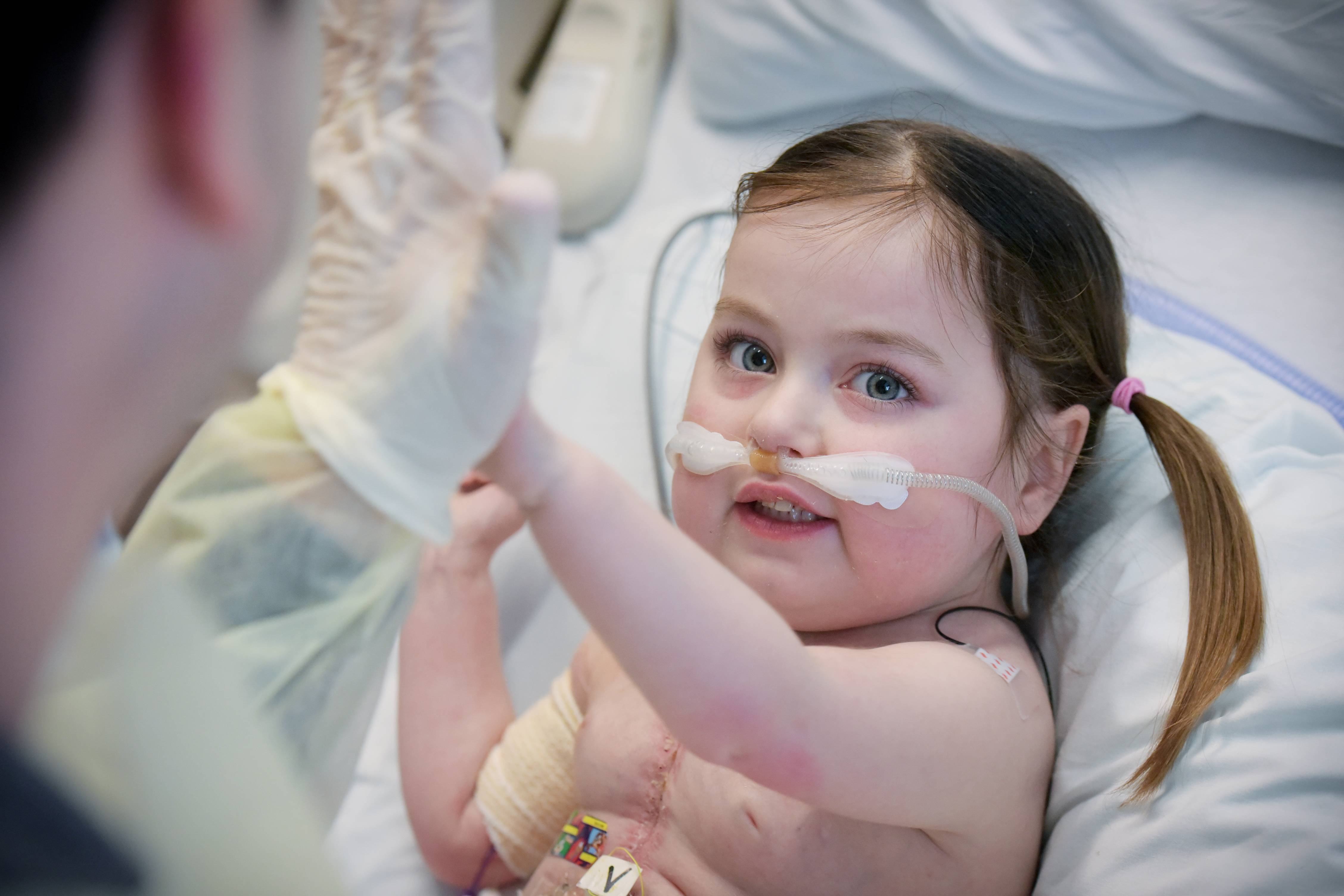 Lucy Shannon gives Dr. Matt Cornicelli a high-five at Ann & Robert H. Lurie Children's Hospital.