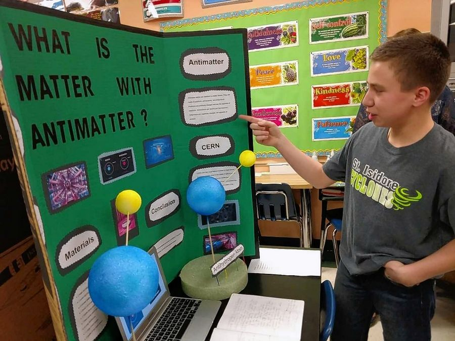 Alex Silveyra, a sixth-grader at St. Isidore Parish School in Bloomingdale, explains his STREAM Night project about antimatter. STREAM is a new concept at the school that builds on the STEM disciplines of science, technology, engineering and math by adding religion and the arts to the mix.