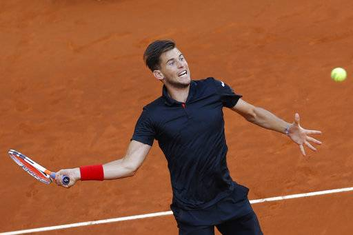 FILE - In this May 13, 2018, file photo, Dominic Thiem, of Austria, returns the ball to Alexander Zverev, of Germany, during the men's final of the Madrid Open Tennis tournament in Madrid, Spain. Thiem will be competing in the French Open tennis tournament that begins on Sunday, May 27.