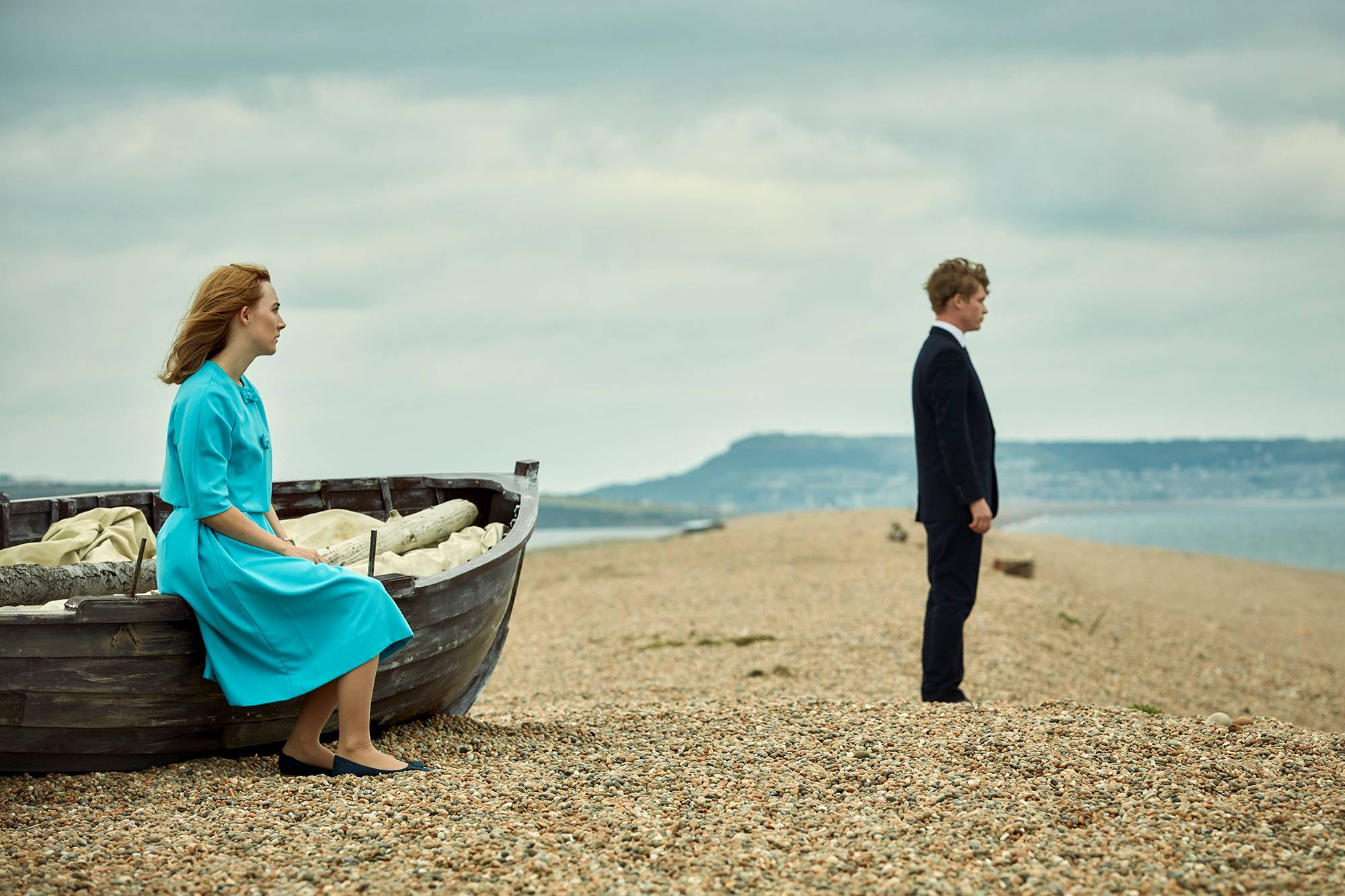 "Florence (Saoirse Ronan) and Edward (Billy Howle) honeymoon on the seashore in ""On Chesil Beach."""