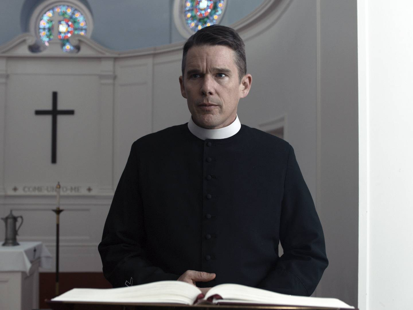 "Reverend Toller (Ethan Hawke) preaches in his church, about to celebrate its 250th anniversary, in ""First Reformed."""