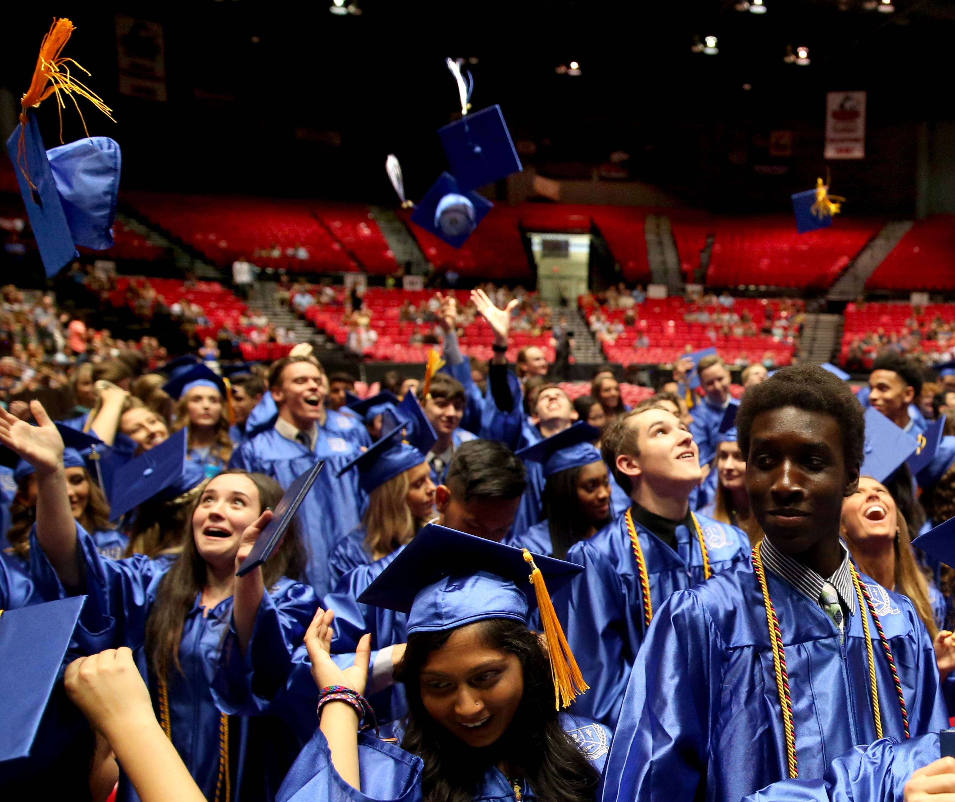 Graduates toss their caps to conclude the commencement program for Burlington Central High School at the Convocation Center on the campus of Northern Illinois University in DeKalb on Thursday, May 24, 2018. The class of 2018 has 249 members.