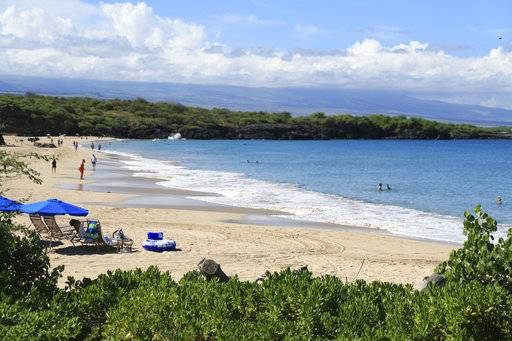 This undated photo provided by Kirk Lee Aeder shows Hapuna Beach in Hawaii. The beach is No. 8 on the list of best beaches for the summer of 2018 compiled by Stephen Leatherman, also known as Dr. Beach, a professor at Florida International University.(Kirk Lee Aeder/www.kirkaederphoto.com via AP)