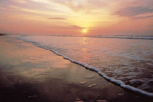 This undated photo provided by the Kiawah Island Golf Resort shows sunrise as seen from Beachwalker Park, Kiawah Island, South Carolina. Beachwalker is No. 10 on the list of best beaches for the summer of 2018 compiled by Stephen Leatherman, also known as Dr. Beach, a professor at Florida International University. (Kiawah Island Golf Resort via AP)