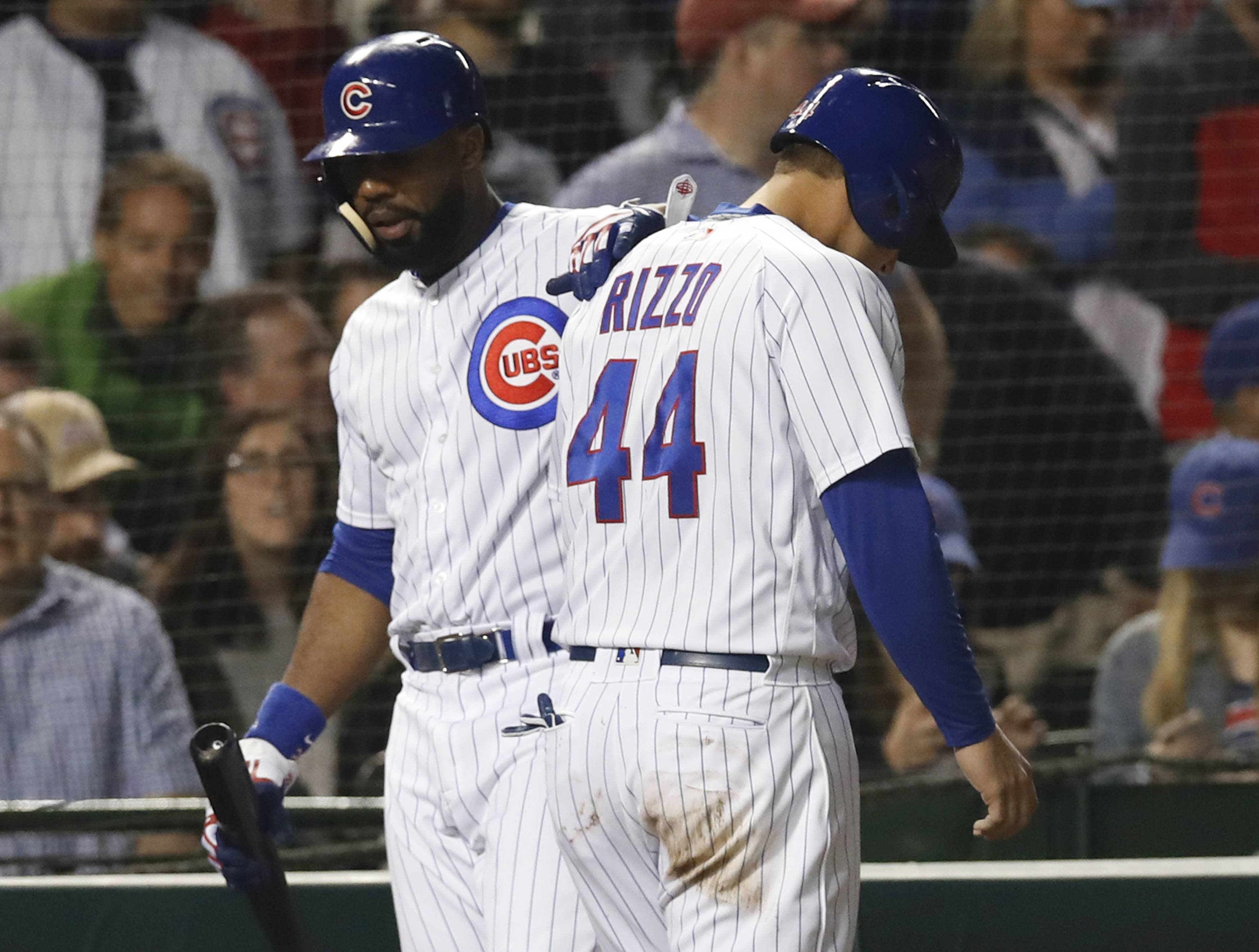 Chicago Cubs' Anthony Rizzo, right, is consoled by Jason Heyward as he walks back to the dugout after being tagged out at home during the seventh inning of the team's baseball game against the Cleveland Indians on Wednesday, May 23, 2018, in Chicago. (AP Photo/Jim Young)