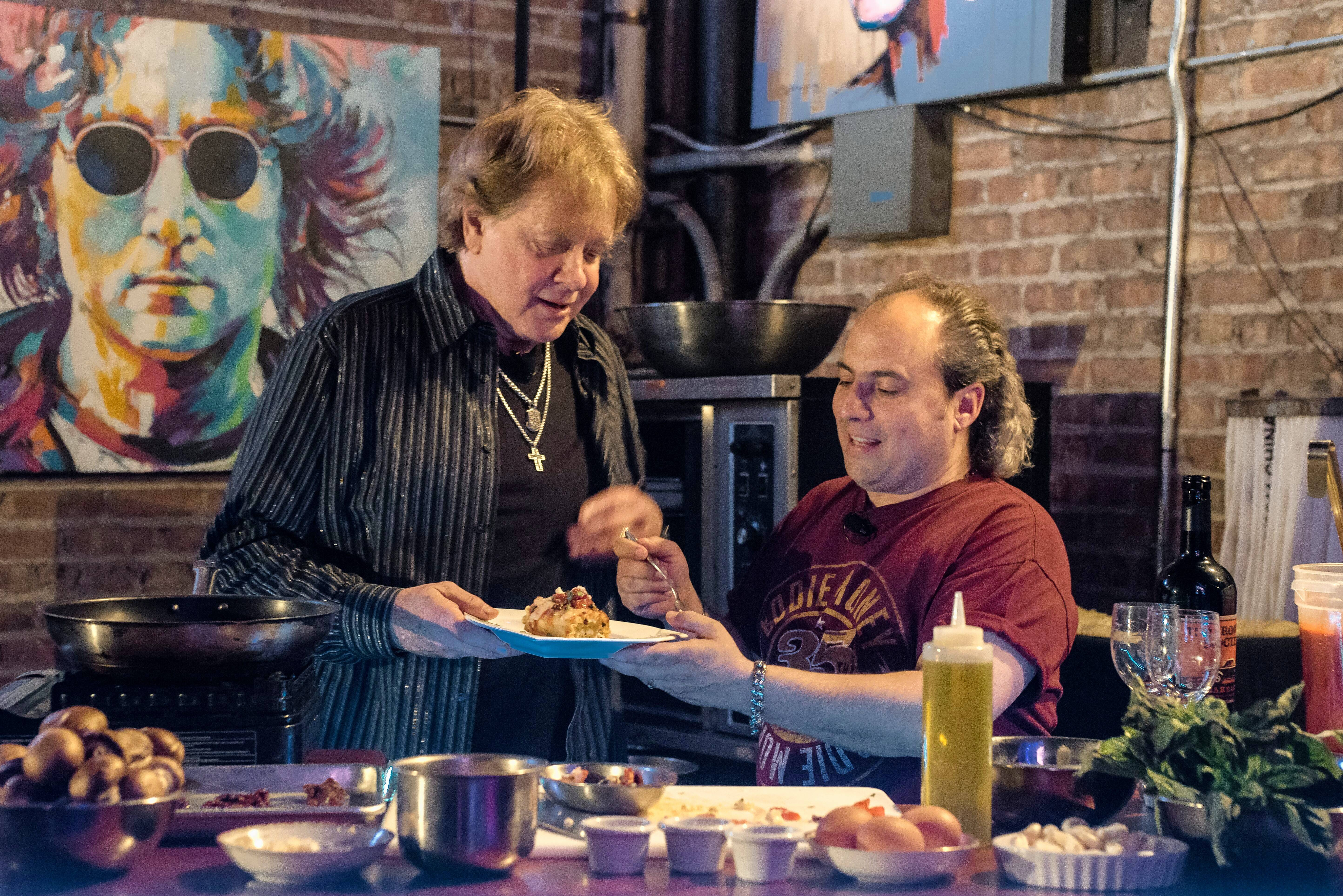 Singer Eddie money and Arcada Theatre owner Ron Onesti make vegetable lasagna prior to Money's show.