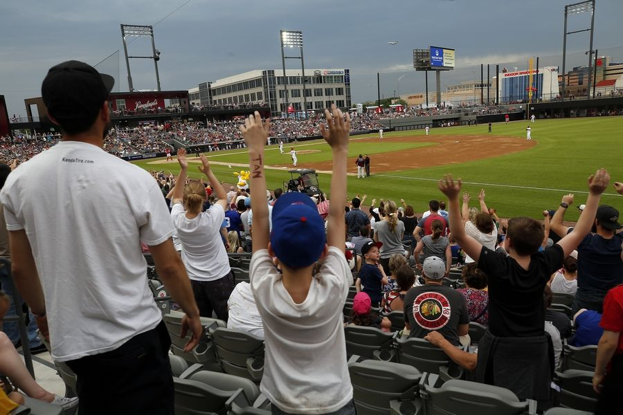 Brian Hill/bhill@dailyherald.comFans cheer Friday during the inaugural game for the Chicago Dogs of the American Association independent baseball league at Impact Field in Rosemont vs. the Kansas City T-Bones.