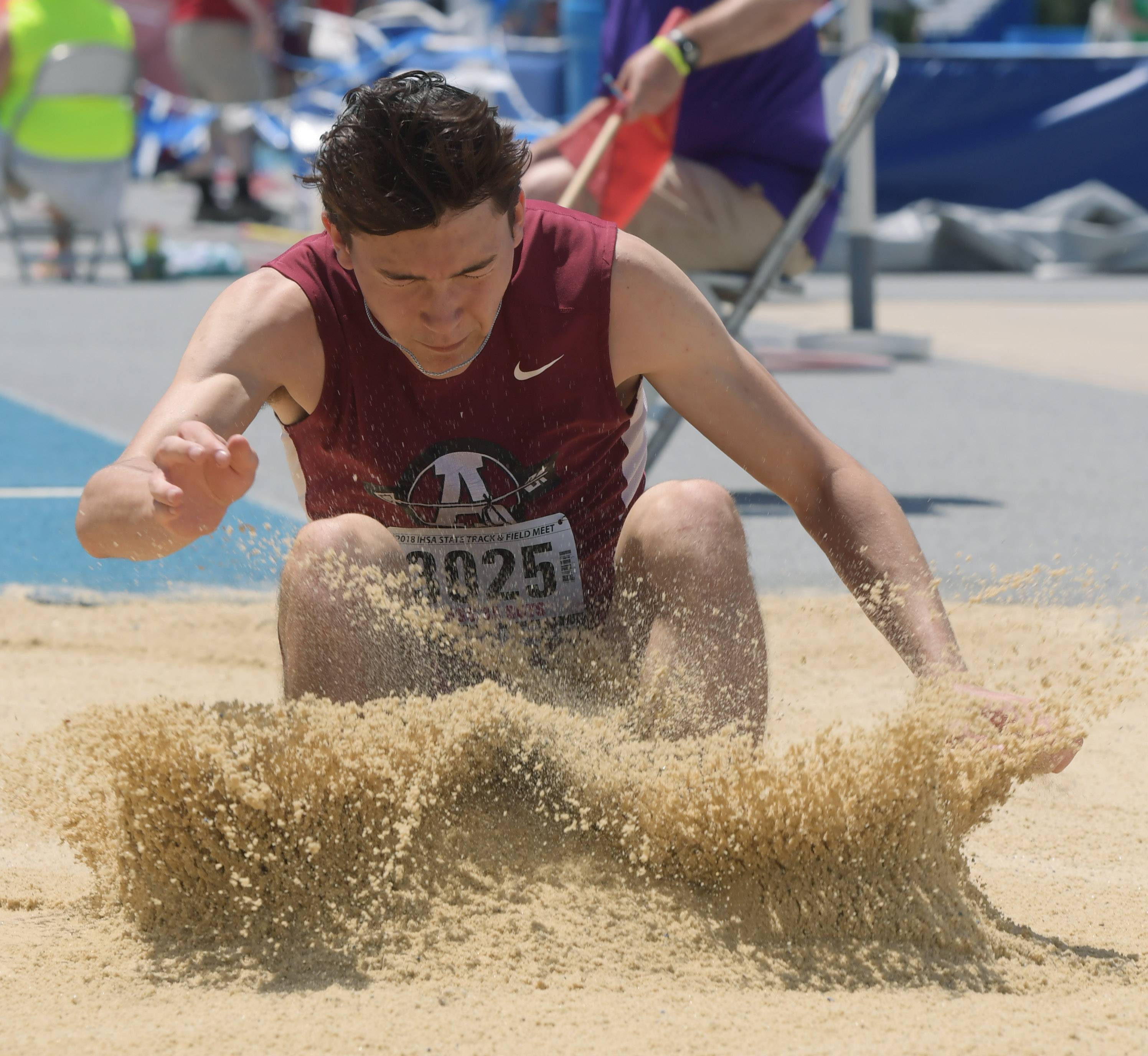 Antioch's Zach Grindley lands as he competes in the long jump during the Class 3A boys state track and field preliminaries in Charleston Friday.