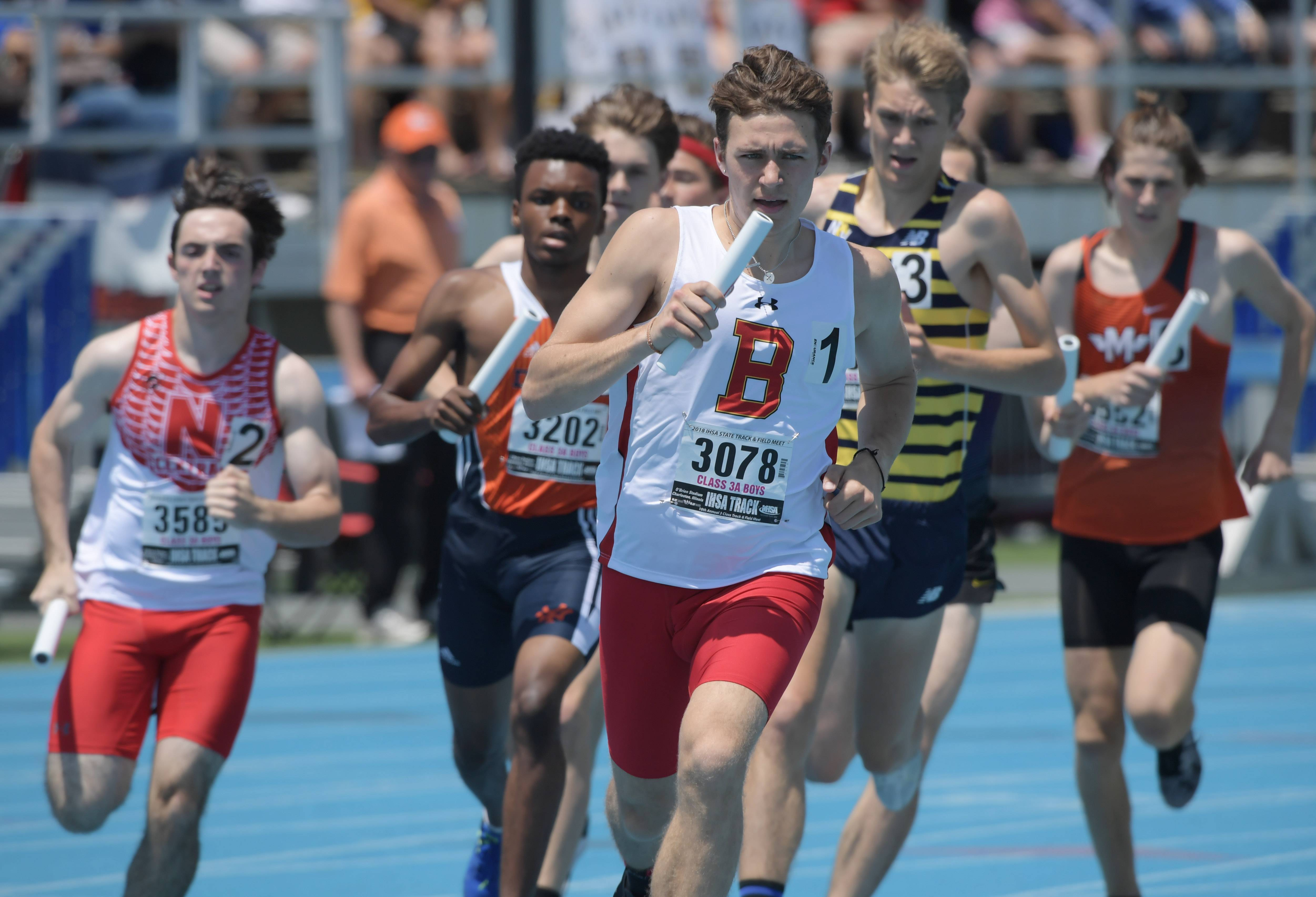 Batavia's Shane Knanishu carries the baton for his team in the 3,200-meter relay during the Class 3A boys state track and field prelims in Charleston Friday.