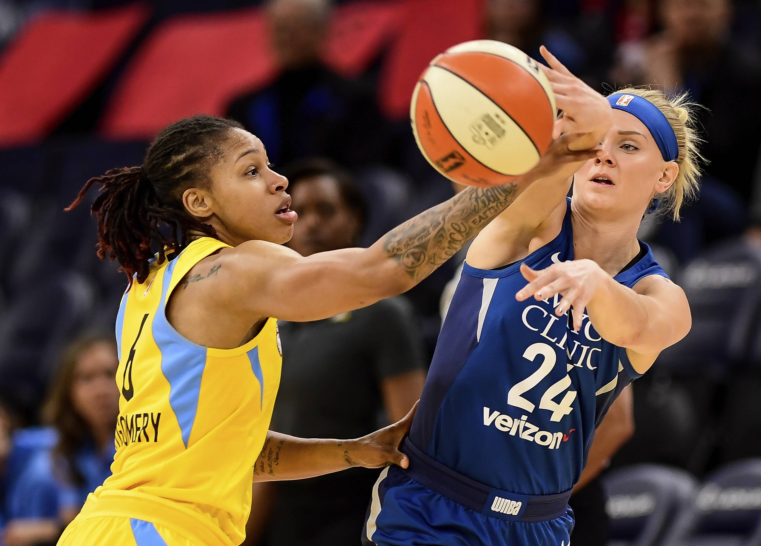 Minnesota Lynx guard Carlie Wagner passes the ball around Chicago Sky forward Alex Montgomery (6) during the second quarter of a WNBA preseason basketball game Saturday, May 12, 2018, in Minneapolis. (Aaron Lavinsky/Star Tribune via AP)