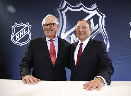 FILE - In this June 22, 2016, file photo, NHL Commissioner Gary Bettman, right, and Bill Foley pose for photographers during a news conference about the expansion franchise in Las Vegas. What Bettman has done for the past 25 years is oversee the growth of the NHL from $437 million in annual revenue to close to $5 billion, guiding it into and out of work stoppages that have made him unpopular in some corners of the sport and among fans, all the while expanding hockey's reach in the U.S. to places that never seemed a fit for the fastest game on ice.