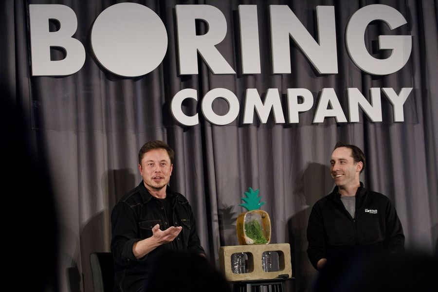 Elon Musk, co-founder and chief executive officer of Tesla Inc., left, and Steve Davis, the operations head of Boring Co., during a Boring event in Los Angeles.
