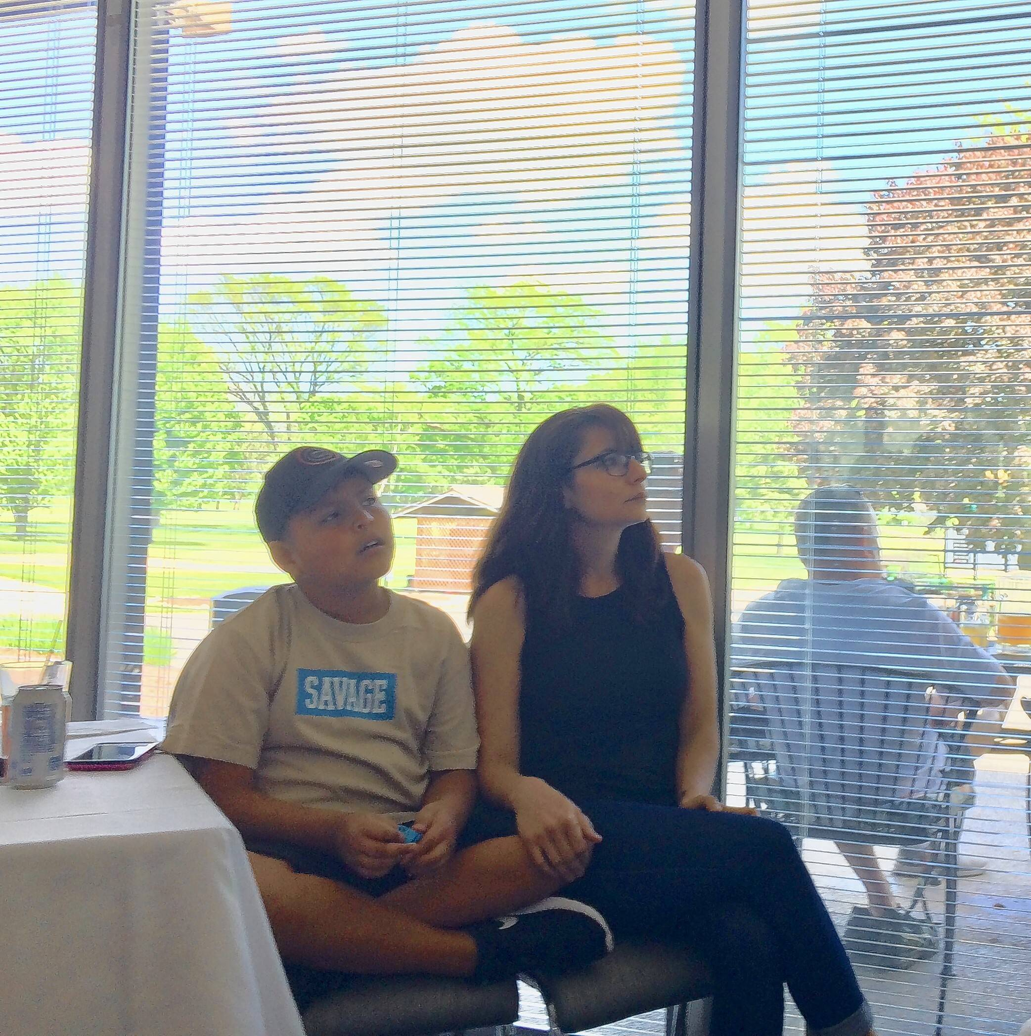 Marine Staff Sgt. Jonathan Davis died in Afghanistan in 2013 and was the subject of a video that debuted Saturday at Old Orchard Country Club in Mount Prospect. Watching were his son Calvin, now 9, and his widow, Helena. Arlington Heights resident and retired Marine Charles Jones wants to produce more videos for the nonprofit Dear Calvin Project named for the boy.